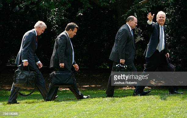 Deputy Chief of Staff Karl Rove waves to photographers as Deputy Chief of Staff Joseph Hagen White House Communications Director Kevin Sullivan and...