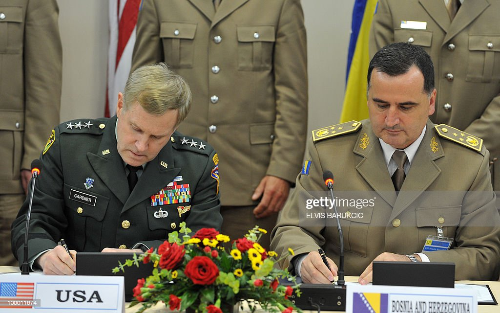 Deputy Commander of US Command in Europe, Lieutenant General John Gardner (L) and Chairman of the Joint Chiefs of Staff of the Armed Forces of Bosnia and Herzegovina, Brigadier General Miladin Milojcic (R) sign a joint statement of The US-Adriatic Charter on regional co-operation in destoying the surplus of weapons and ammounition on May 20, 2010. Bosnia and Herzegovina hosted high level military forum of The US-Adriatic Charter consisted of military leadership of Western-Balakan countries that already entered or aspire to enter into NATO membership.