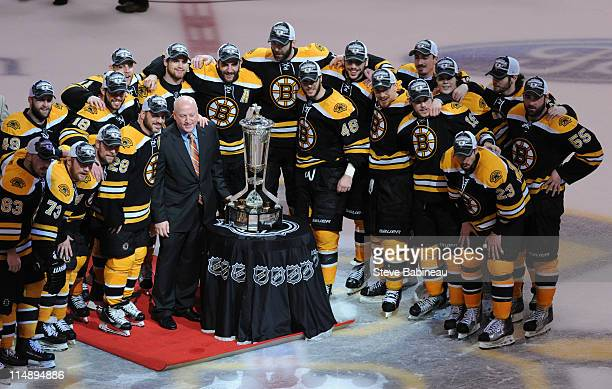 Deputy Comminissioner Bill Daly presents the Prince of Wales Trophy to the Boston Bruins after the game against the Tampa Bay Lightning in Game Seven...