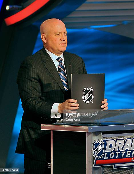 Deputy Commisioner Bill Daly of he National Hockey League displays an NHL envelope during the Draft Lottery on April 18 2015 at the Sportsnet Studios...