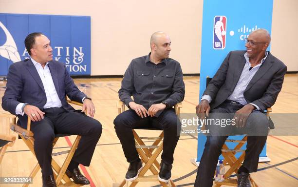NBA Deputy Commissioner and Chief Operating Officer Mark Tatum Cisco Chief Technologist Chintan Patel and NBA hall of famer Clyde Drexler during a...