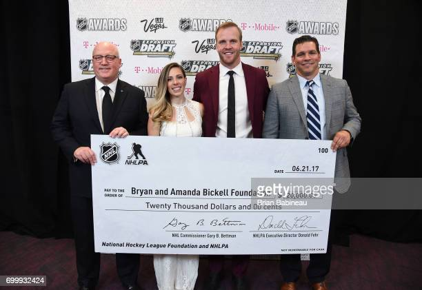 NHL Deputy Commissioner Bill Daly Amanda Bickell Bryan Bickell and Steve Webb of the NHLPA pose with a check donation to the Bryan and Amanda Bickell...