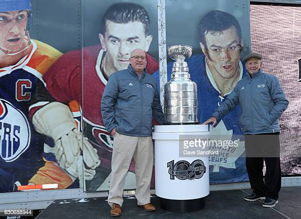 Deputy Commissioner Bill Daly and Hockey Hall of Famer and NHL legend Dave Keon pose onstage at the NHL Centennial Fan Arena unveiling as part of the...