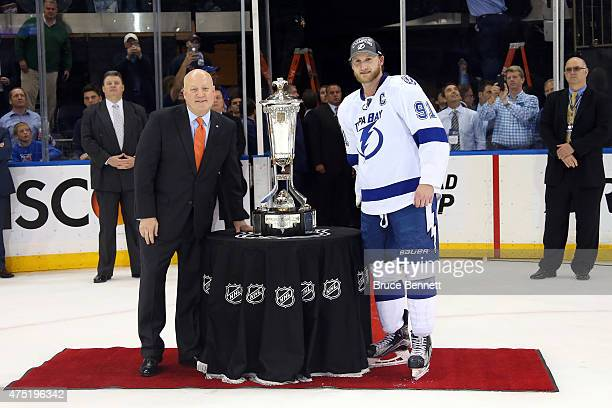 NHL Deputy Commissioner Bill Daly and Steven Stamkos of the Tampa Bay Lightning pose with the Prince of Wales Trophy after Game Seven of the Eastern...
