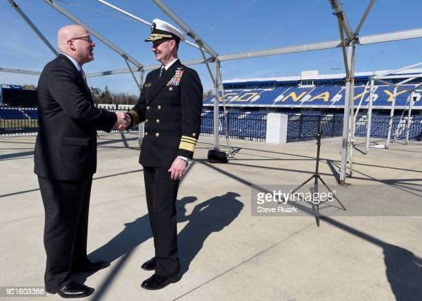 NHL Deputy Commissioner Bill Daly and US Naval Academy Superintendent Vice Admiral Walter E 'Ted' Carter shake hands after a news conference to mark...