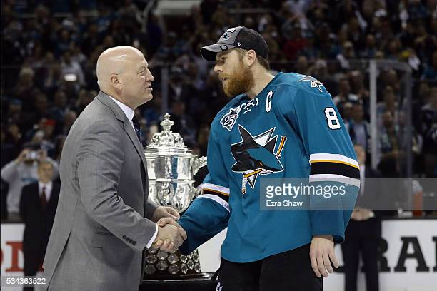 Deputy Commissioner Bill Daly awards Joe Pavelski of the San Jose Sharks the Clarence S Campbell Bowl for winning the Western Conference Final after...