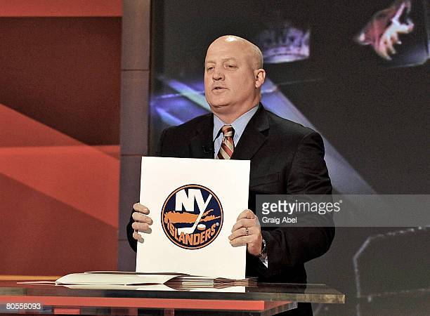 Deputy Commissioner Bill Daly holds up a NHL Draft lottery card April 7 2008 at the TSN Studios in Toronto Ontario Canada