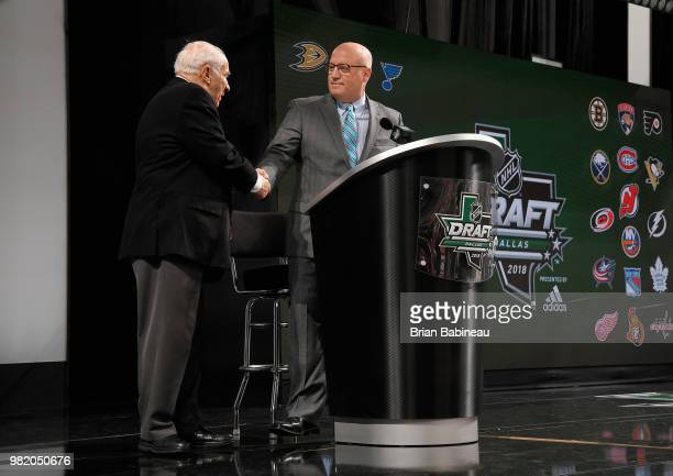 Deputy Commissioner Bill Daly pays tribute to NHL Executive Jim Gregory during the 2018 NHL Draft at American Airlines Center on June 23 2018 in...