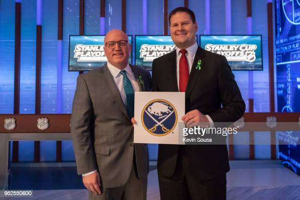 Deputy Commissioner Bill Daly poses with Buffalo Sabres General Manager Jason Botterill after the Buffalo Sabres won the first overall pick during...