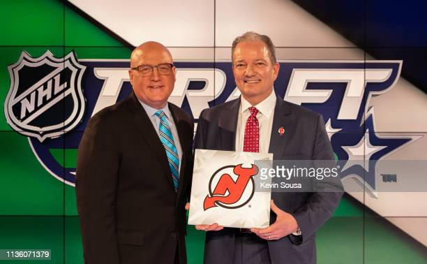 Deputy Commissioner Bill Daly poses with New Jersey Devils General Manager Ray Shero after the New Jersey Devils won the first overall pick during...