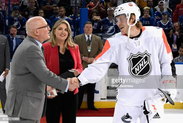 NHL deputy commissioner Bill Daly presents Brock Boeser of the Vancouver Canucks the award for the 2018 Honda NHL AllStar Game MVP after the 2018...