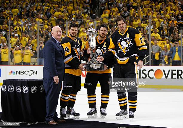 Deputy Commissioner Bill Daly presents Chris Kunitz Sidney Crosby and Evgeni Malkin of the Pittsburgh Penguins with the Prince of Wales Trophy after...
