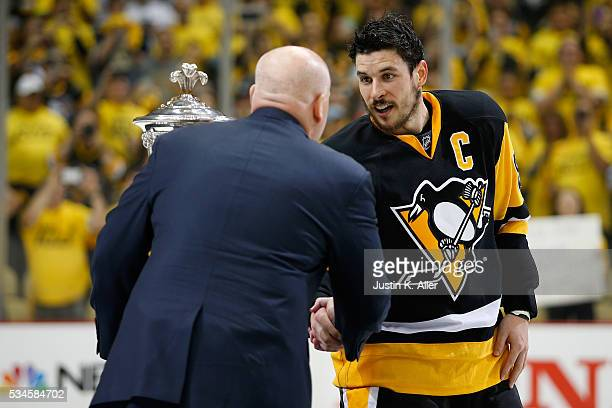 NHL Deputy Commissioner Bill Daly presents Sidney Crosby of the Pittsburgh Penguins with the Prince of Wales Trophy after defeating the Tampa Bay...