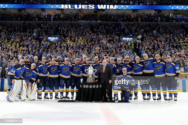 Deputy Commissioner Bill Daly presents the Clarence S Campbell Bowl to the St Louis Blues after defeating the San Jose Sharks in Game Six with a...