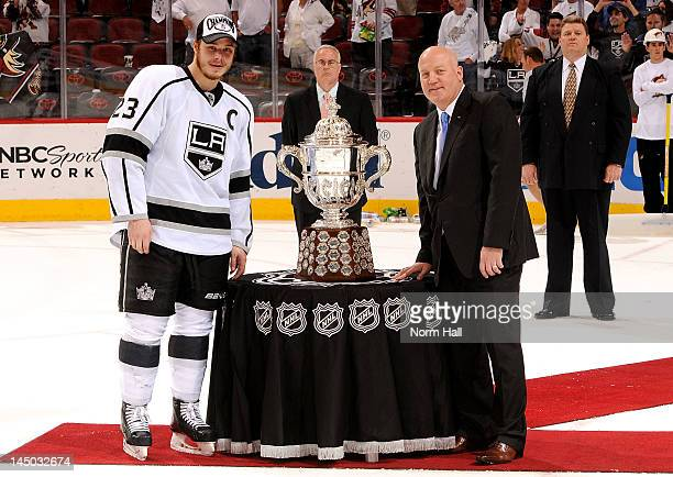 Deputy Commissioner Bill Daly presents the Clarence S Campbell Bowl to Dustin Brown of the Los Angeles Kings after Game Five of the Western...