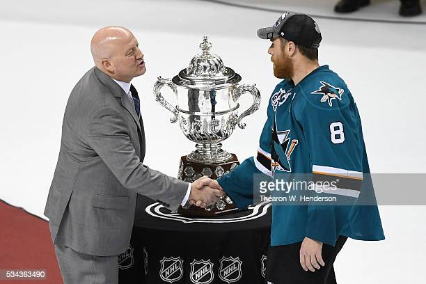 Deputy Commissioner Bill Daly presents the Clarence S Campbell Bowl to Joe Pavelski of the San Jose Sharks after their 52 win over the St Louis Blues...