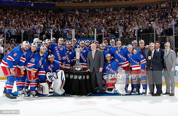Deputy Commissioner Bill Daly presents the New York Rangers with the Prince of Wales Trophy after defeating the Montreal Canadiens in Game Six of the...