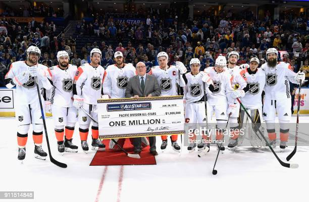Deputy Commissioner Bill Daly presents the Pacific Division AllStars the one million dollar check after the 2018 Honda NHL AllStar Game between the...