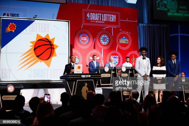 Deputy Commissioner Mark Tatum awards the Phoenix Suns the number one pick in the 2018 NBA Draft during the 2018 NBA Draft Lottery at the Palmer...