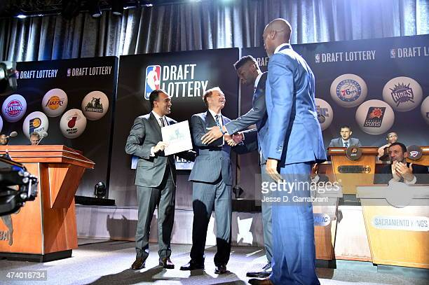 Deputy Commissioner Mark Tatum congrats Owner Glen Taylor of the Minnesota Timberwolves for winning the 2015 NBA Draft Lottery reception on May 19...