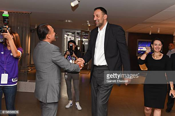 Deputy Commissioner Mark Tatum shakes hands with Vlade Divac General Manager of the Sacramento Kings before the game against the San Antonio Spurs on...
