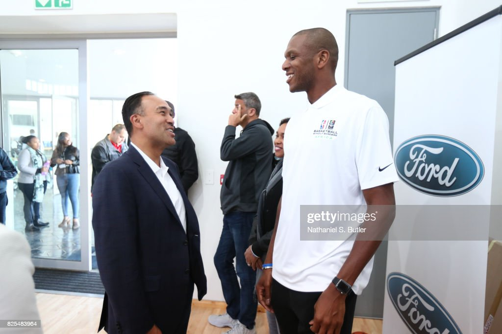 NBA Deputy Commissioner Mark Tatum speaks with James Jones during the Basketball Without Borders Africa at the American International School of Johannesburg on August 2, 2017 in Gauteng province of Johannesburg, South Africa.