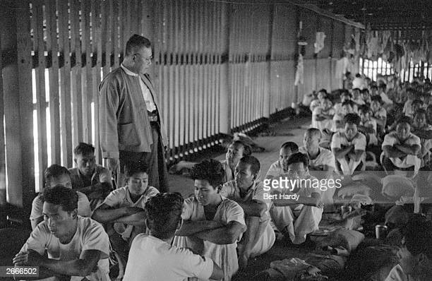 Deputy commissioner of Mandalay U Sein Gyaw watching over communist detainees at a Burmese prison Original Publication Picture Post 4748 Burma The...