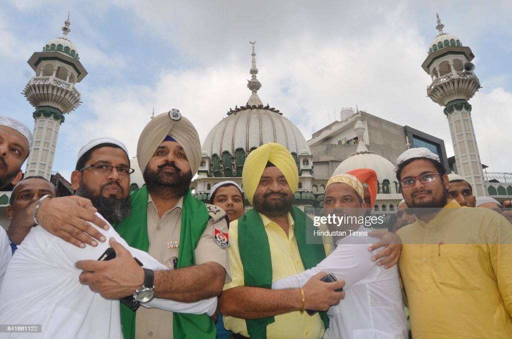 Deputy Commissioner Of Police AS Powar and ACP Central Narinder Singh greet muslims on the occasion of Eid alAdha the festival of sacrifice on...