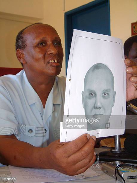 Deputy Commissioner of Police William Langat shows a computergenerated sketch of one of the suspects involved in last month's attack on Israeli...