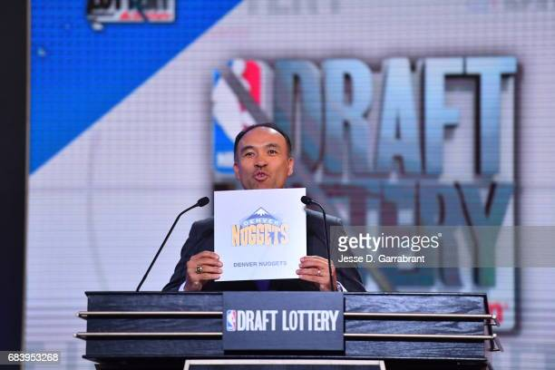 Deputy Commissioner of the NBA Mark Tatum announces the Denver Nuggets 13th pick during the 2017 NBA Draft Lottery at the New York Hilton in New York...