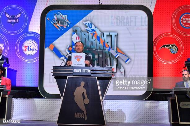 Deputy Commissioner of the NBA Mark Tatum announces the New York Knicks 8th pick during the 2017 NBA Draft Lottery at the New York Hilton in New York...