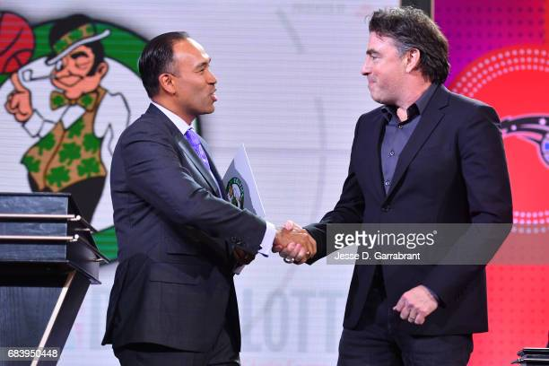 Deputy Commissioner of the NBA Mark Tatum shakes hands with Wyc Grousbeck of the Boston Celtics after announcing the Boston Celtics 1 pick during the...