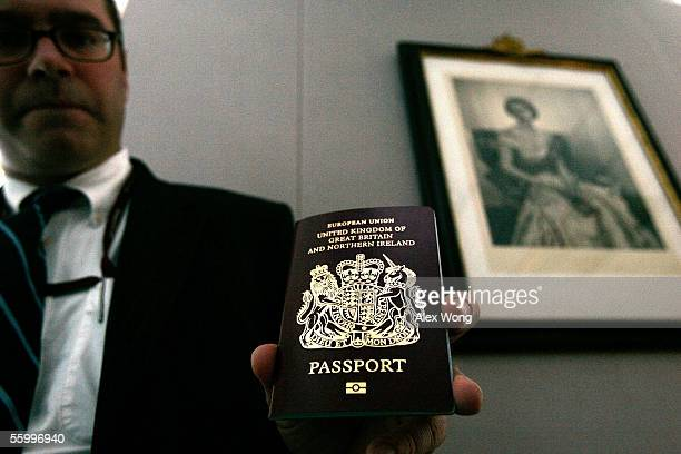 Deputy ConsulGeneral and Director of UK Consular Operations in the USA Graeme Wise shows reporters the new British biometric European Union passport...