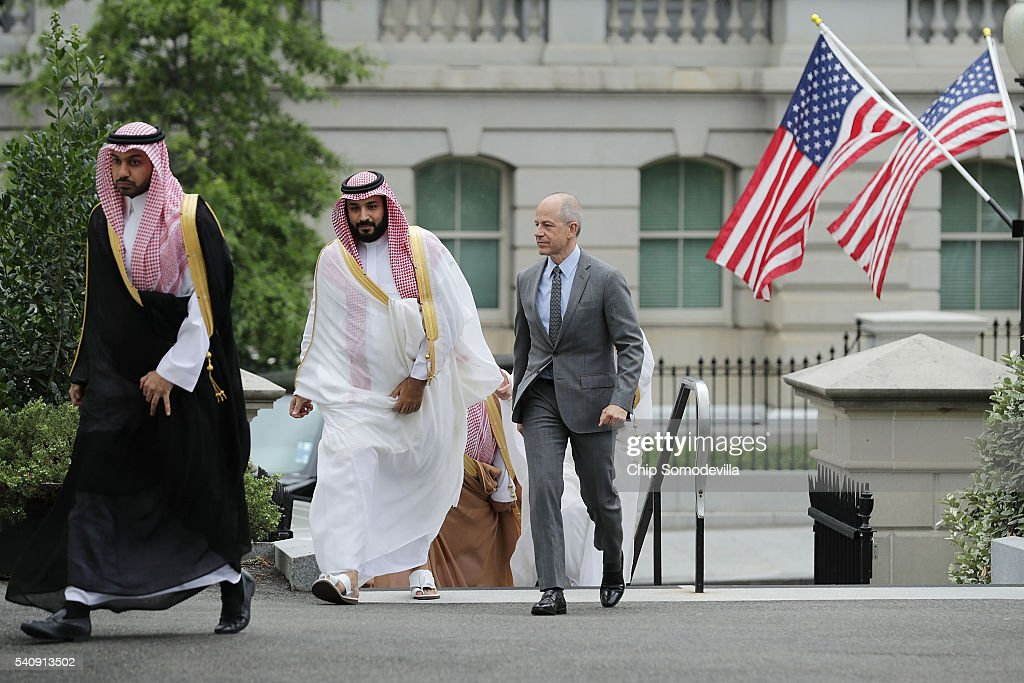 Deputy Crown Prince and Minister of Defense Mohammed bin Salman of Saudi Arabia (C) is escorted by U.S. Deputy Chief of Protocol Mark Walsh (R) as they walk into in the White House on June 17, 2016 in Washington, DC. The deputy crown prince will meet privately with U.S. President Barack Obama to discuss issues 'including de-escalating regional conflicts, our campaign against ISIL, Saudi Arabia's National Transformation Program, and efforts to further progress on the objectives agreed to at the U.S.-GCC Summit in April,' according to the White House.