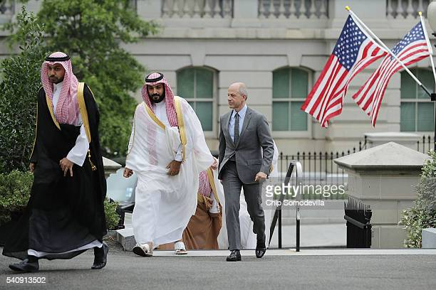 Deputy Crown Prince and Minister of Defense Mohammed bin Salman of Saudi Arabia is escorted by US Deputy Chief of Protocol Mark Walsh as they walk...