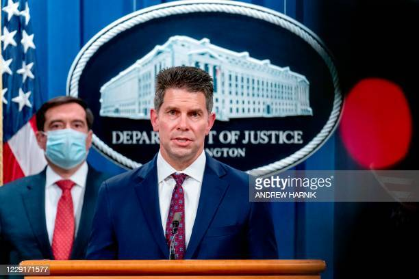 Deputy Director David Bowdich, accompanied by Assistant Attorney General for the National Security Division John Demersspeaks at a news conference at...