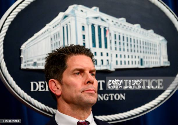 FBI Deputy Director David Bowdich looks on during a press conference regarding the December 2019 shooting at the Pensacola Naval air station in...