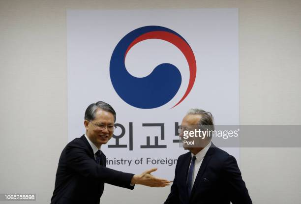 Deputy Director General and Head of the Department of Safeguards, Massimo Aparo is greeted by South Korean Deputy Foreign Minister for Multilateral...