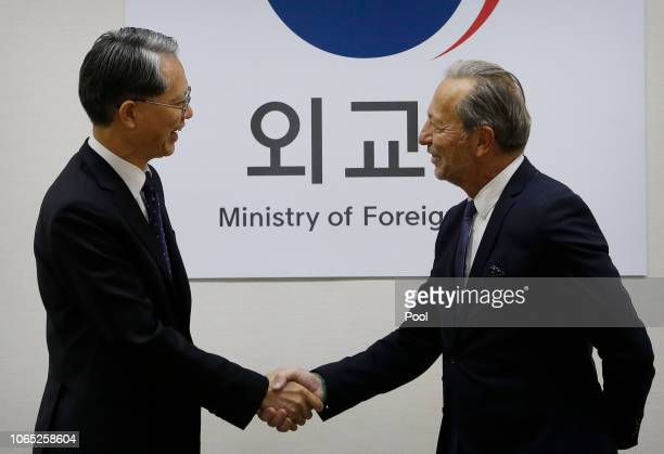 Deputy Director General and Head of the Department of Safeguards, Massimo Aparo shakes hands with South Korean Deputy Foreign Minister for...