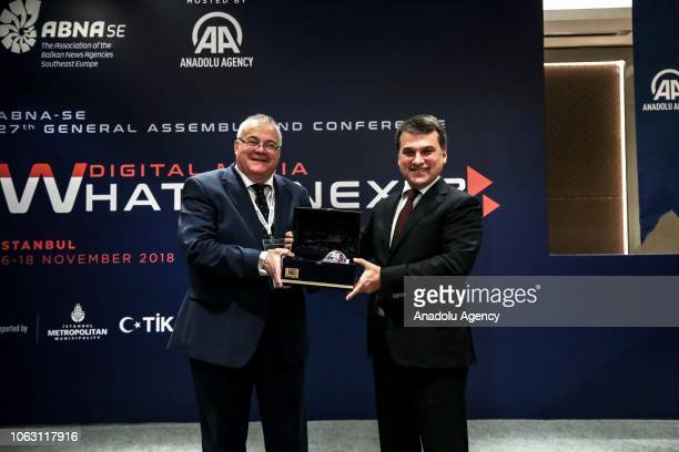 Deputy Director General of Anadolu Agency Mustafa Ozkaya gives a present to Michalis Psilos head of the AthensMacedonia News Agency after the 27th...
