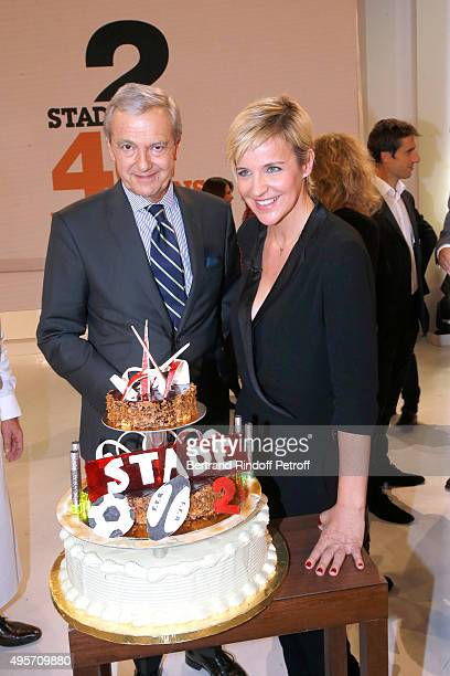 Deputy Director General of France Televisions for Sports Daniel Bilalian and Presenter of Stade 2 Celine Geraud pose in front of the Birthday Cake of...