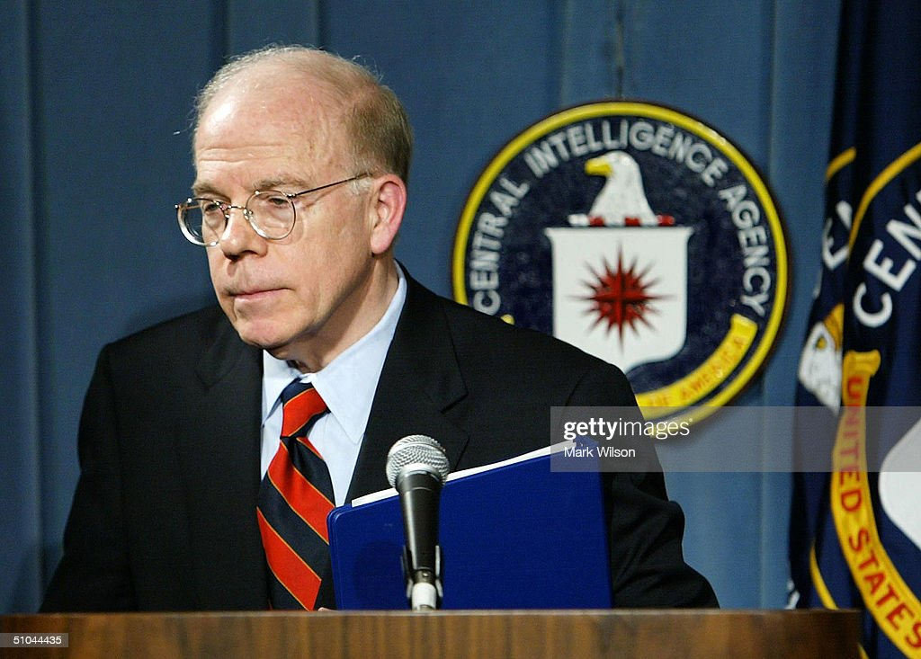 Deputy Director of Central Intelligence John E. McLaughlin carries his papers after giving the CIA's response to the Senate intelligence report, July 9, 2004 at CIA headquarters in Langley, Virginia. Earlier today the Senate Intelligence Committee released its report on the numerous failures in the CIA reporting of alleged Iraqi weapons of mass destruction.