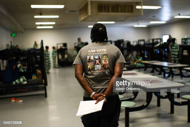 DENVER CO SEPTEMBER Deputy director of Colorado Criminal Justice Reform Coalition Juston Cooper speaks to a room of female inmates about their voting...