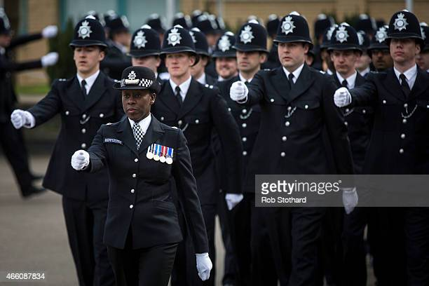 Deputy Director of Training Superintendent Robyn Williams leads new recruits to the Metropolitan Police Service during their 'Passing Out Parade' at...