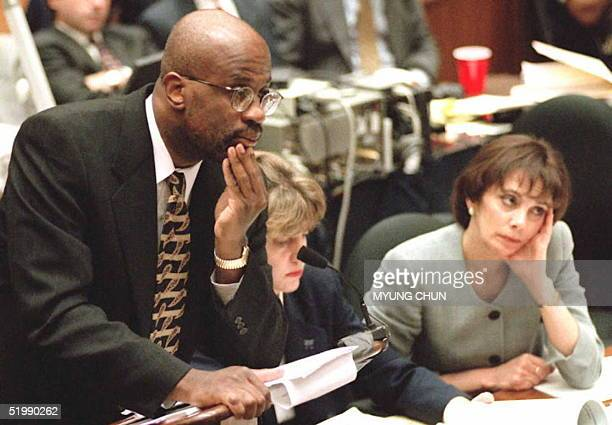 Deputy District Attorney Christopher Darden listens to screenwriter Laura Hart McKinny concerning her interviews with Los Angeles police detective...