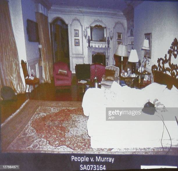 Deputy District Attorney David Walgren displays an image of Micheal Jackson's Holmby Hills bedroom while questioning Alberto Alvarez one of Michael...