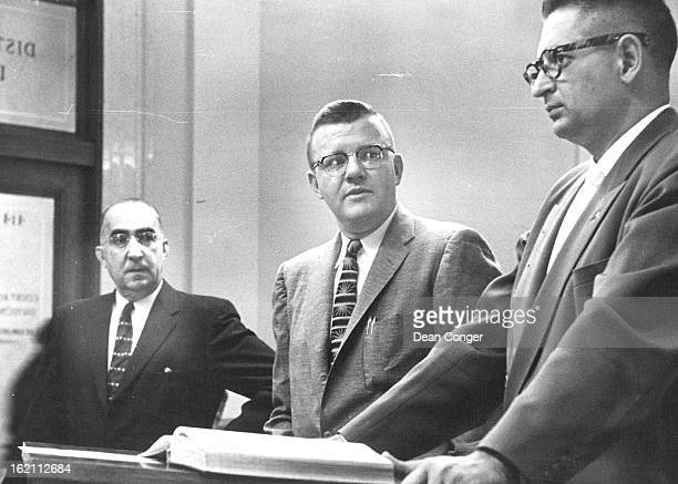 SEP 18 1956 SEP 18 1960 Deputy District Attorney Henry Santo who is prosecuting the torturerobbery case against Sam and Ernest Abeyta confers with...