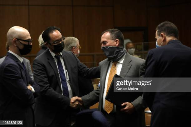 Deputy District Attorney John Lewin, center, is congratulated as attorney Habib A. Balian, right, looks on after New York real estate heir Robert...