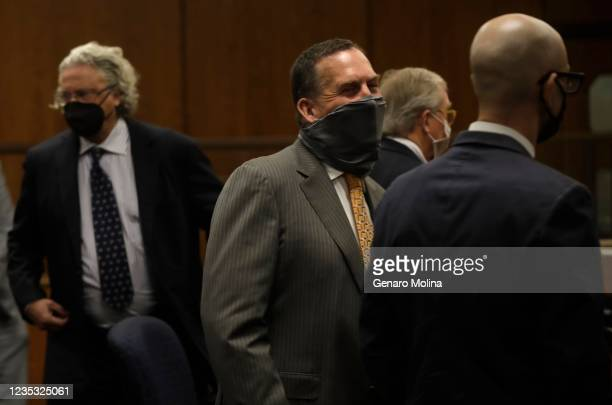 Deputy District Attorney John Lewin, center, smiles under his mask after New York real estate heir Robert Durst was found guilty of murdering...