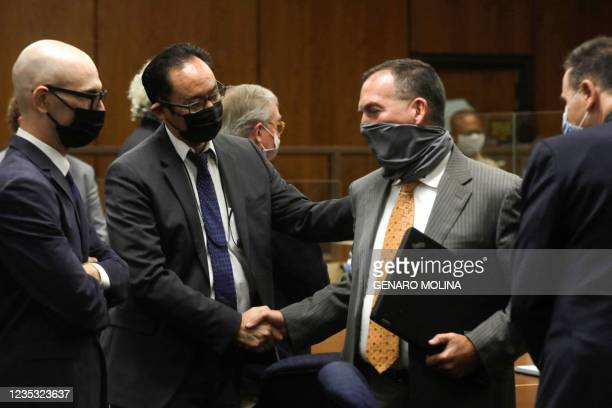 Deputy District Attorney John Lewin is congratulated as attorney Habib A. Balian after New York real estate heir Robert Durst was found guilty of...